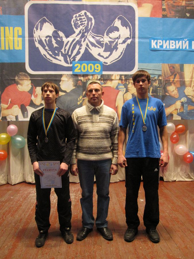 That's my trainer, Victor Alekseyavich, with the guys from our group who placed.